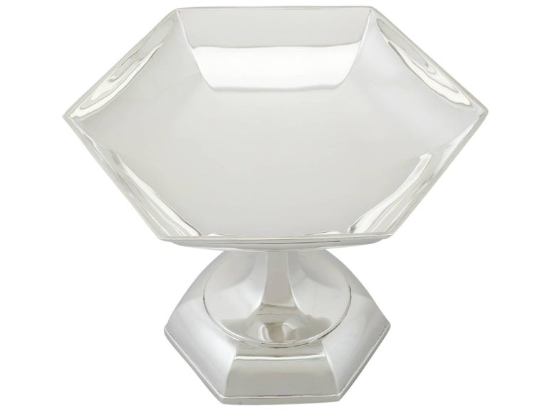 An exceptional, fine and impressive antique George V English sterling silver tazza (pedastalled dish) by Walker and Hall in the Art Deco style; an addition to our Art Deco silverware collection.  This exceptional antique George V sterling silver