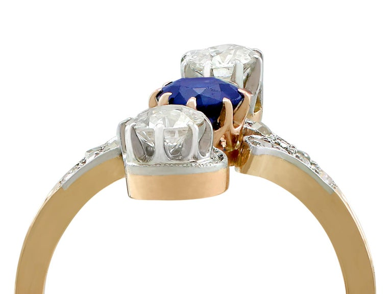 A stunning antique 0.62 carat sapphire and 1.21 carat diamond, 14 karat yellow and white gold twist ring; part of our diverse antique jewelry and estate jewelry collections.  This stunning, fine and impressive antique sapphire ring has been crafted
