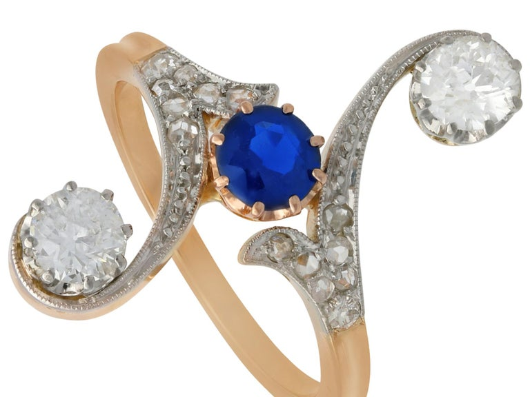 Round Cut 1910s Antique Sapphire and 1.21 Carat Diamond Yellow Gold Twist Ring For Sale