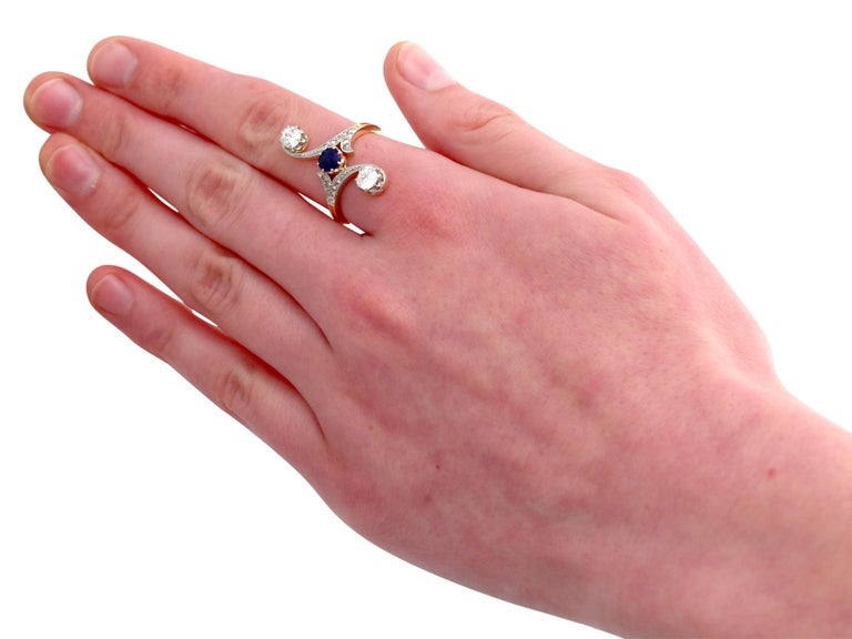 1910s Antique Sapphire and 1.21 Carat Diamond Yellow Gold Twist Ring For Sale 1