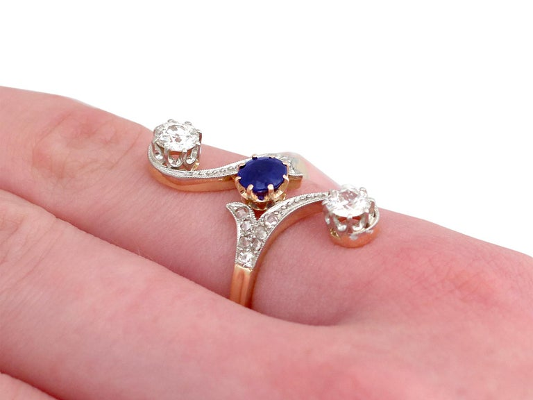 1910s Antique Sapphire and 1.21 Carat Diamond Yellow Gold Twist Ring For Sale 2