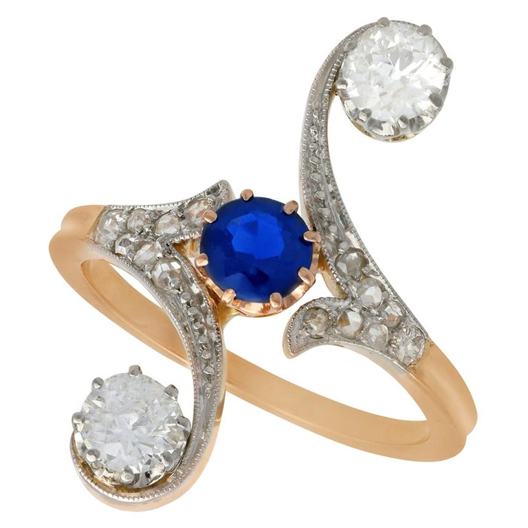 1910s Antique Sapphire and 1.21 Carat Diamond Yellow Gold Twist Ring For Sale