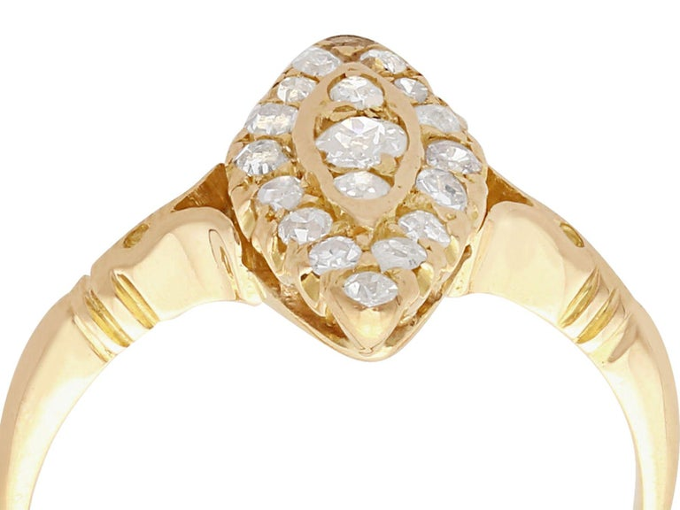 An impressive antique 0.41 carat diamond and 14 karat yellow gold marquise shaped dress ring; part of our diverse antique jewelry and estate jewelry collections  This fine and impressive marquise shaped diamond cluster ring has been crafted in 14k