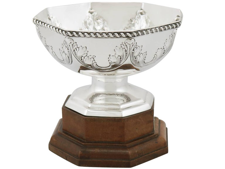 An exceptional, fine and impressive antique George V English sterling silver presentation bowl on plinth; an addition to our ornamental silverware collection.