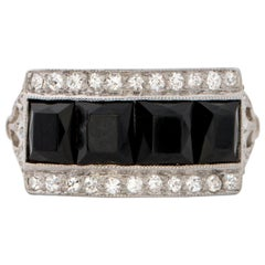 1915 .25 Carat Diamond and Onyx Platinum Ring