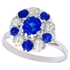 1915 Antique 1.04 Carat Sapphire and Diamond Platinum Cluster Ring
