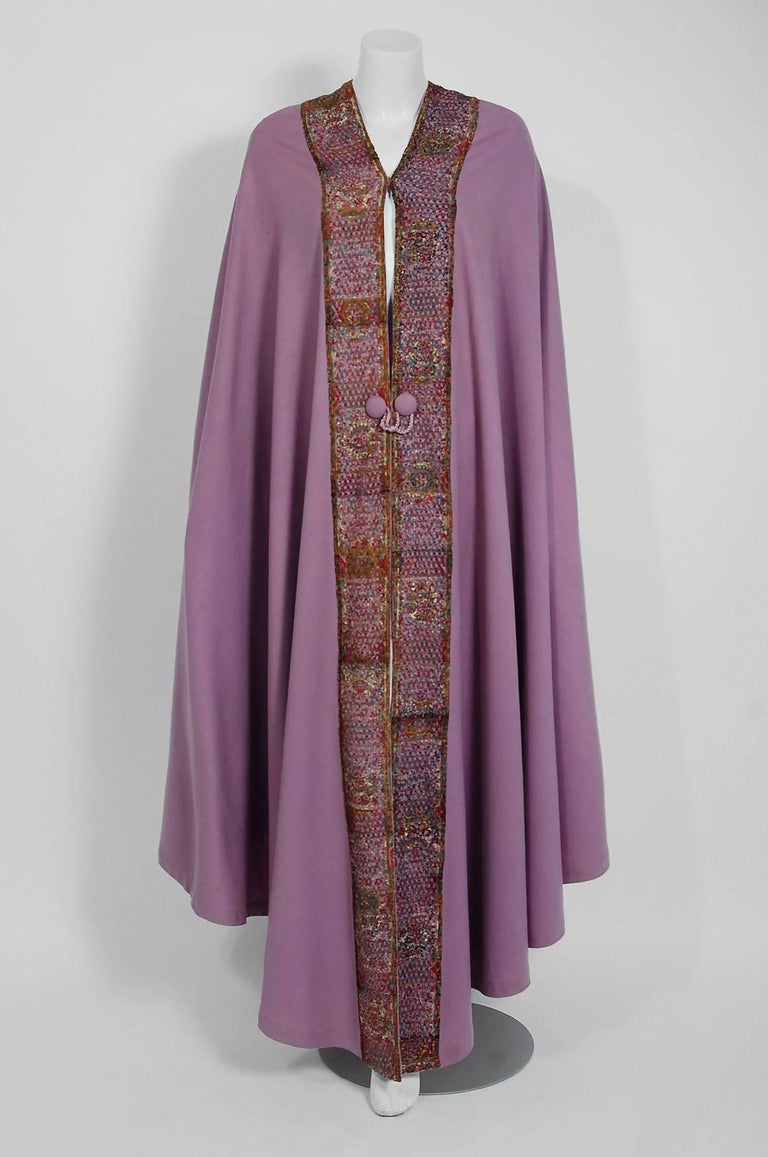 Breathtaking Liberty Paris Couture wool cape dating back to the mid 1910's. Liberty was one of the first designers to embrace the Art-Nouveau movement. The fashion house saw the need to make fashions that were more stylish, but at the same time keep