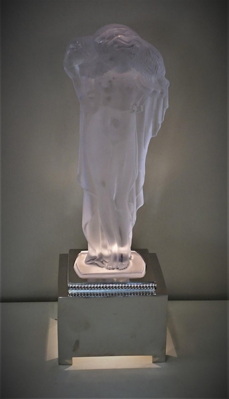 Clear high light polished frost heavy crystal with nickel finish base table lamp slightly draped young woman tenderly carrying a sheep on her shoulders. Signed in front crystal de Sèvres n ° 611/2000.