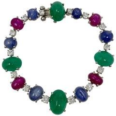 1920 Antique 32.50 Carat Emerald, Blue Sapphire, Ruby and Diamond Bracelet