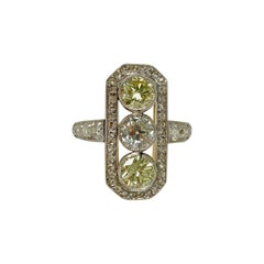 1920 Antique White and Yellow Diamond Ring in Platinum and 18 Karat Yellow Gold