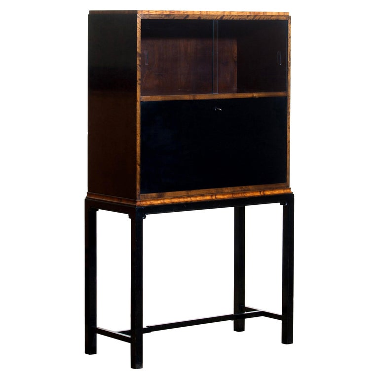 1920s, unique secretaire designed by Axel Einar Hjorth and manufactured in 1924 by Nordiska Kompaniet, numbered L228. This unique Art Deco secretaire is designed as an come-in to the USA for Nordiska Kompaniet.  The secretaire is veneered with