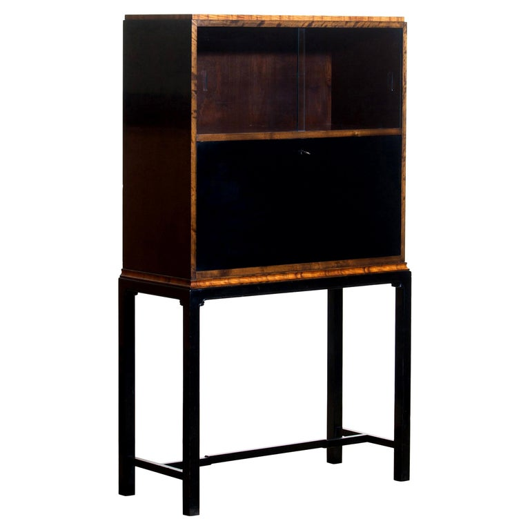 1920s, unique secretaire designed by Axel Einar Hjorth and manufactured in 1924 by Nordiska Kompaniet, numbered L228. This unique Art Deco secretaire is designed as a come-in to the USA for Nordiska Kompaniet.  The secretaire is veneered with