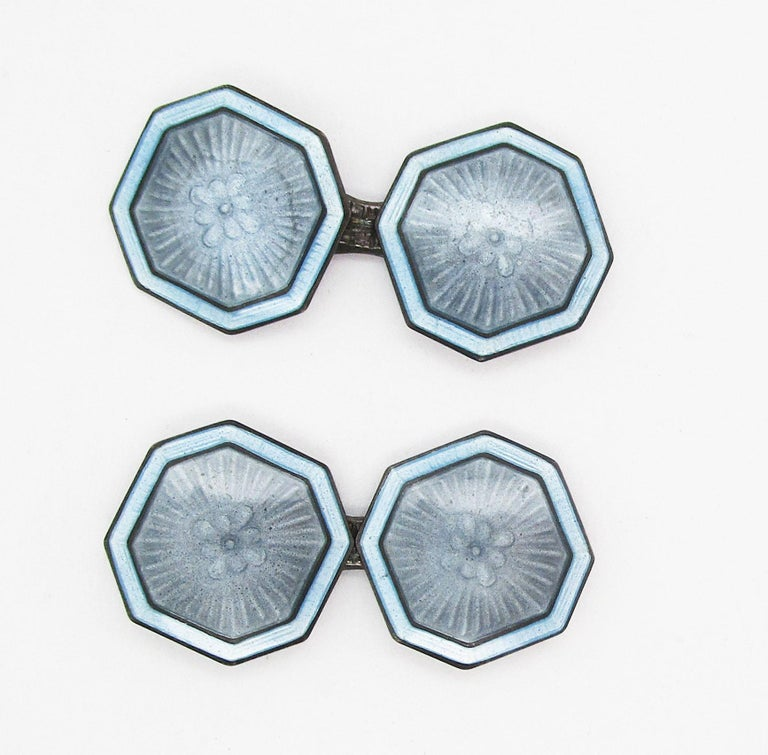 These fantastic cufflinks are from the Art Deco movement of the early 1920s and feature a great combination of sterling silver and pale blue enamel. The links have a unique cut-corner square shape that makes them stand out right away. The subtle