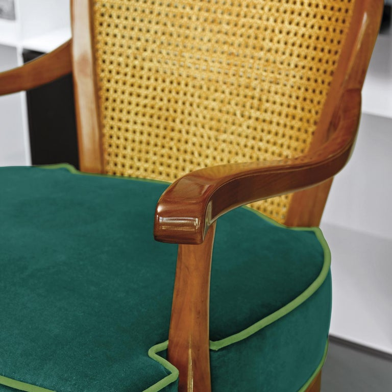 Armchair in 1920 style with double cane on the back, upholstered with foam seat cushion.