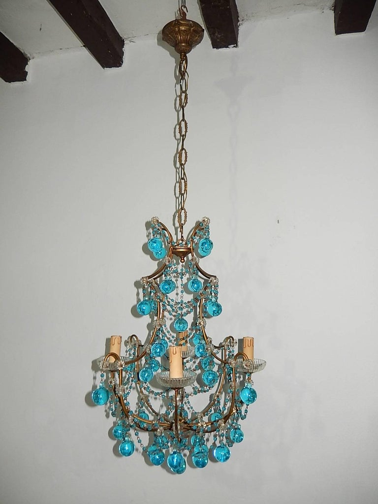 Housing four lights, sitting in crystal bobeches. Rewired and ready to hang. Gilt metal with swags of aqua beads. Florets throughout with small bulbous Murano aqua balls. Free priority shipping from Italy. Add 20