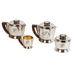 1920 Jean E. Puiforcat, Tea and Coffee Service in Sterling Silver and Macassar