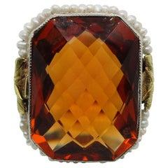 1920s 10 Karat White Gold Filigree 13.89 Carat Citrine and Seed Pearl Ring