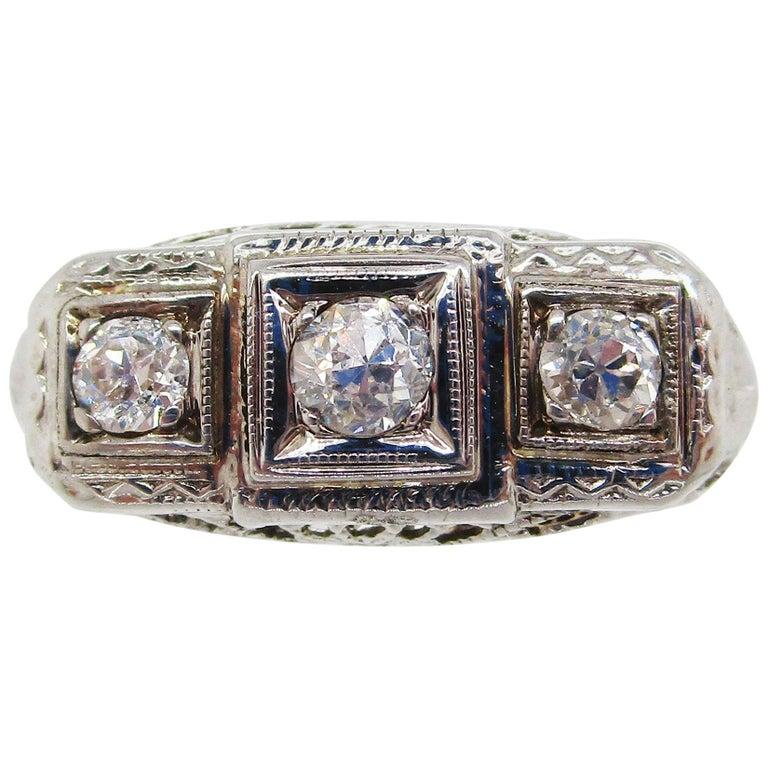 1920s 14 Karat White Gold Filigree Three Diamond Engagement Ring For Sale