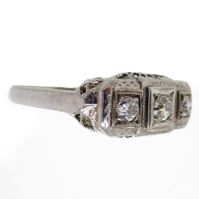 1920s 14 Karat White Gold Filigree Three Diamond Engagement Ring In Excellent Condition For Sale In Lexington, KY