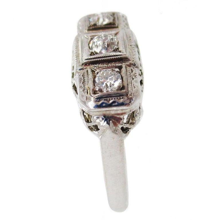 Women's 1920s 14 Karat White Gold Filigree Three Diamond Engagement Ring For Sale