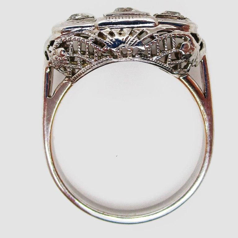 1920s 14 Karat White Gold Filigree Three Diamond Engagement Ring For Sale 1