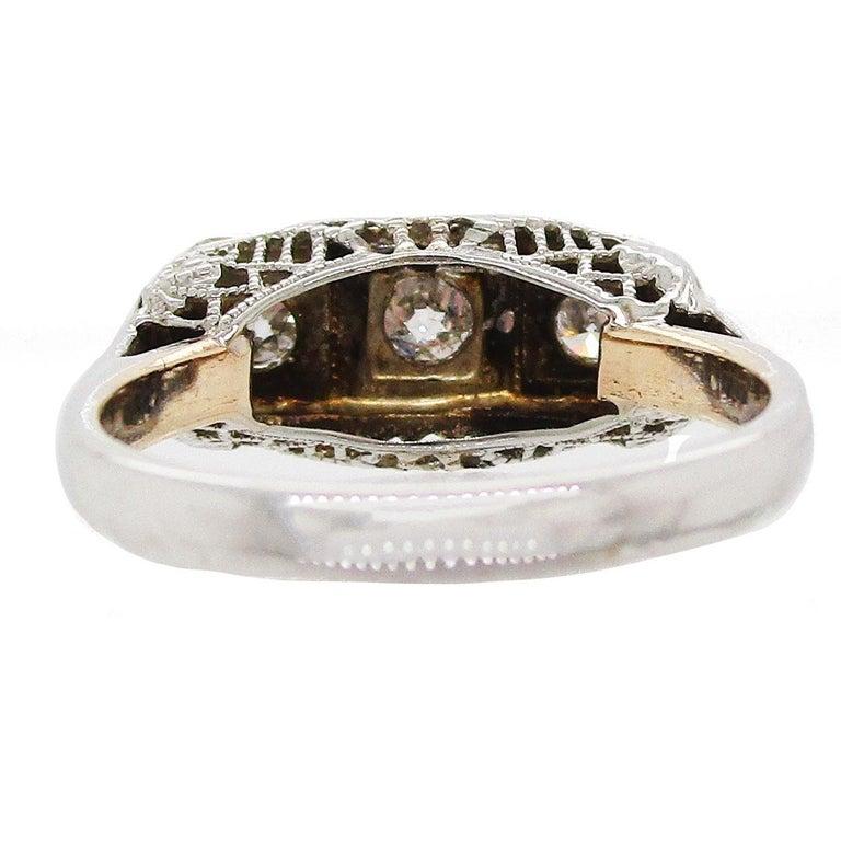 1920s 14 Karat White Gold Filigree Three Diamond Engagement Ring For Sale 2