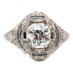1920s 1.59 Carat Diamond Art Deco Platinum Ring with French Cut Sapphires
