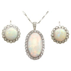 1920s 8.18 Carat Opal and Diamond Earring and Pendant Set