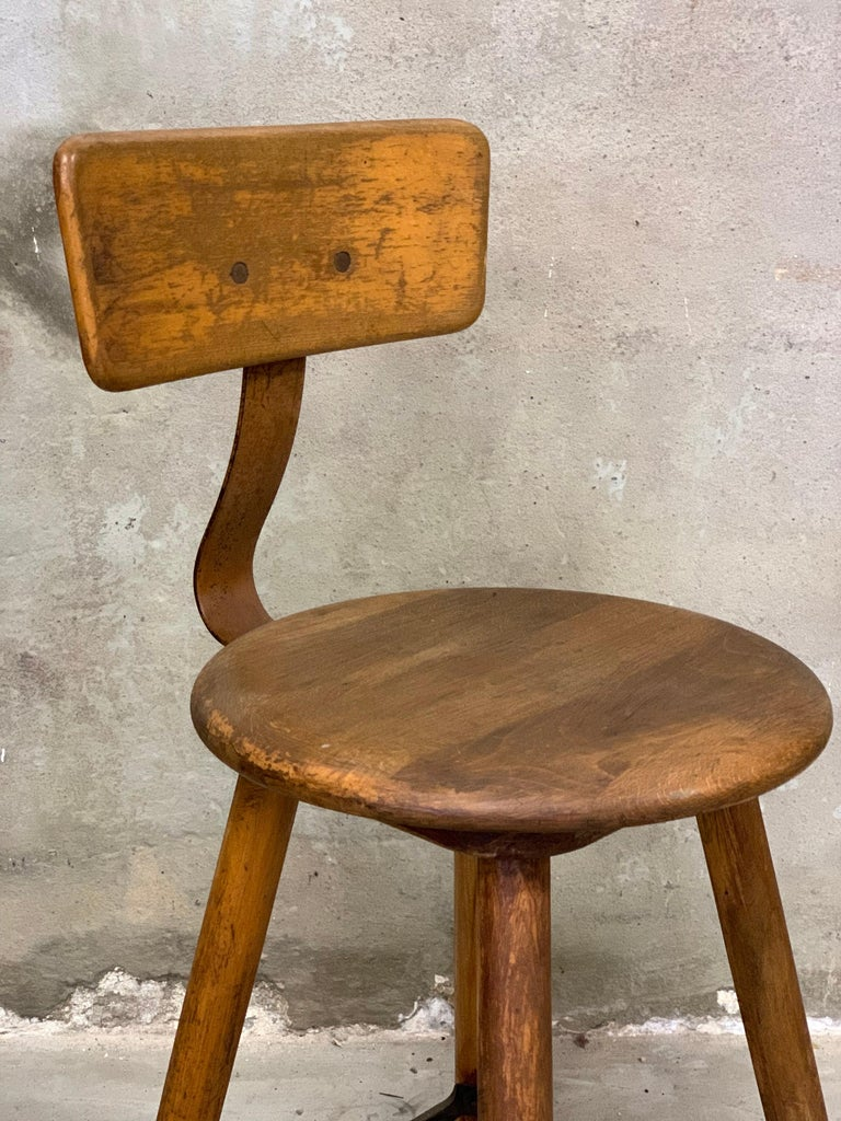 Very nice and in good condition original Ama stool from Germany, wood with partly metal frame. Seat height 58 cm. Diameter 36 cm. With backrest 88 cm high.  From the 1920s-1930s. Clean and treated. Nice item for the lover of rare industrial pieces.