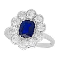 1920s Antique 1.07 Carat Sapphire and 1.54 Carat Diamond Platinum Cluster Ring