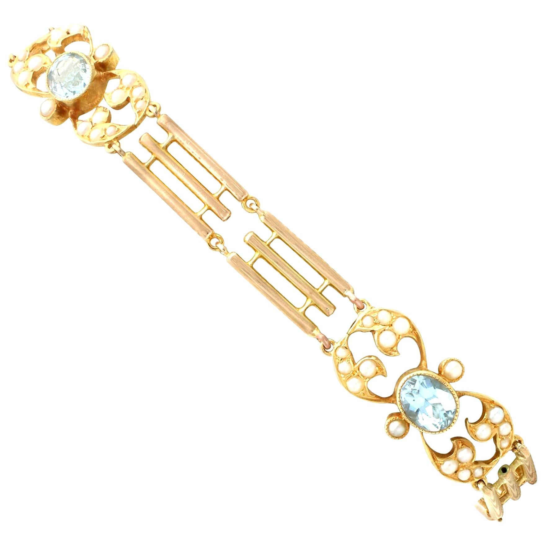 1920s Antique 2.55 Carat Aquamarine and Seed Pearl Yellow Gold Gate Bracelet