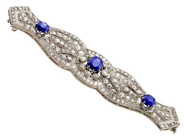A stunning, fine and impressive antique 2.98 carat diamond and 2.90 carat natural blue sapphire brooch in platinum; part of our authentic antique jewelry/jewelry collection.  This stunning, fine and impressive antique sapphire brooch has been