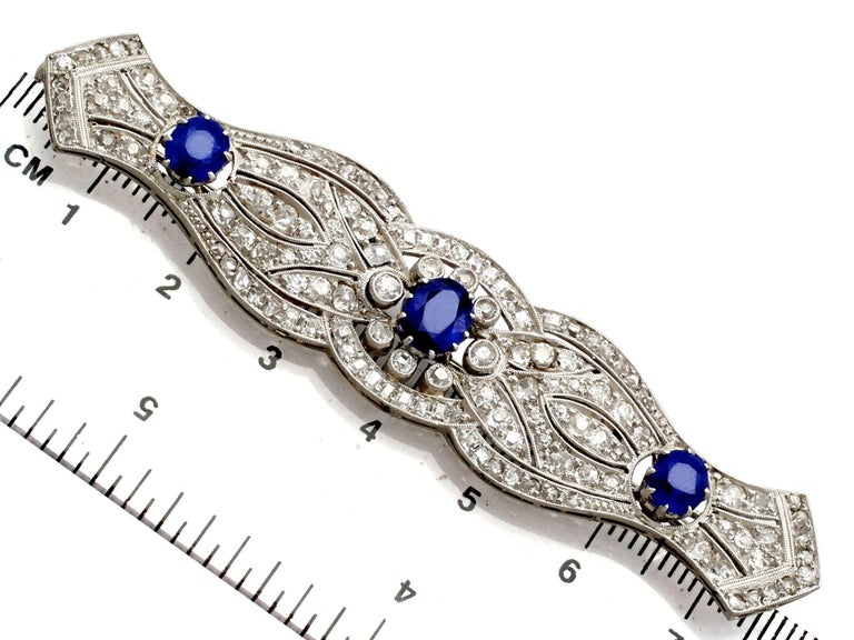 1920s Antique 2.90 Carat Sapphire and 2.98 Carat Diamond Platinum Brooch For Sale 3