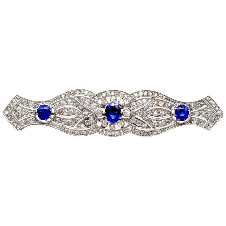 1920s Antique 2.90 Carat Sapphire and 2.98 Carat Diamond Platinum Brooch For Sale