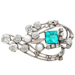 1920s Antique 3.19 Carat Emerald 4.38 Carat Diamond and Pearl Gold Brooch