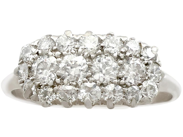 Round Cut 1920s Antique Diamond and Platinum Cluster Ring For Sale
