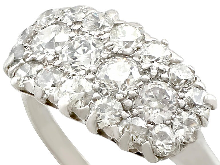 A fine and impressive antique 0.96 carat diamond and platinum cluster style cocktail ring; part of our diverse antique jewelry and estate jewelry collections  This fine and impressive pavé set diamond ring has been crafted in platinum.  The pierced