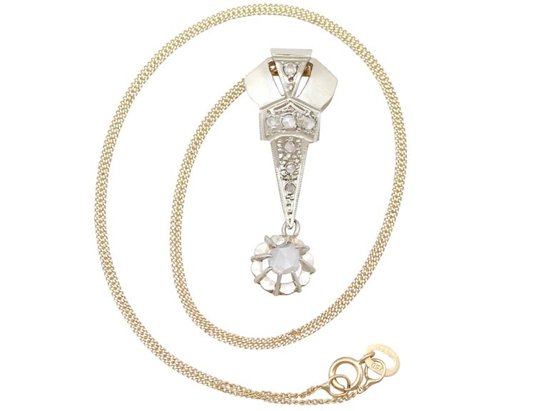 An impressive antique Art Deco 0.37 carat diamond and 18 karat yellow gold, 18 karat white gold set pendant; part of our diverse antique jewellery and estate jewelry collections.  This fine and impressive Art Deco diamond pendant has been crafted in