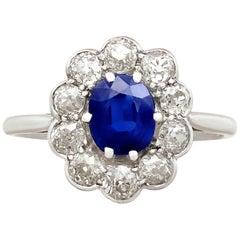 1920s Antique Sapphire and 1.15 Carat Diamond Platinum Cluster Ring