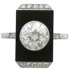 1920s Art Deco 2.56 Carat Diamond and Black Onyx Platinum Cocktail Ring