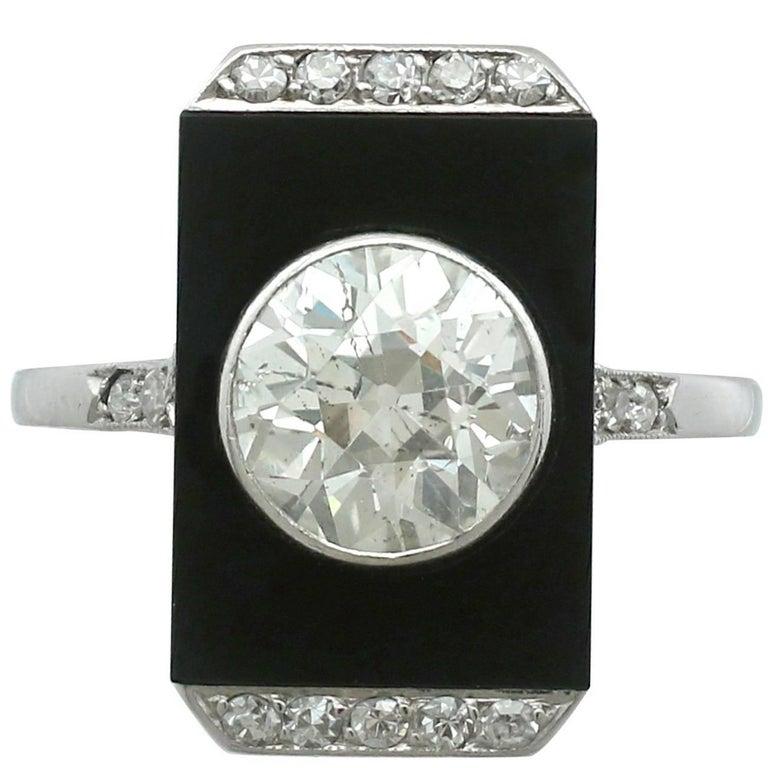 1920s Art Deco 2.56 Carat Diamond and Black Onyx Platinum Cocktail Ring