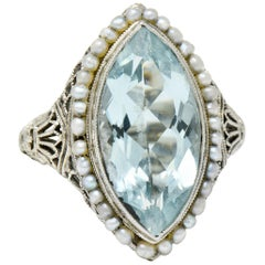 1920s Art Deco Aquamarine Seed Pearl 18 Karat White Gold Navette Dinner Ring