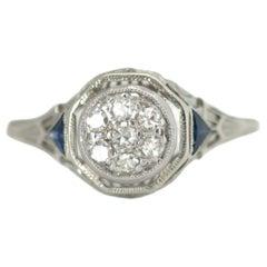 1920s Art Deco Diamond, Blue Sapphire and 18 Karat White Gold Filigree Ring