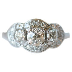 1920s Art Deco GIA 1.25 Carat Diamond Three-Stone White Gold Engagement Ring
