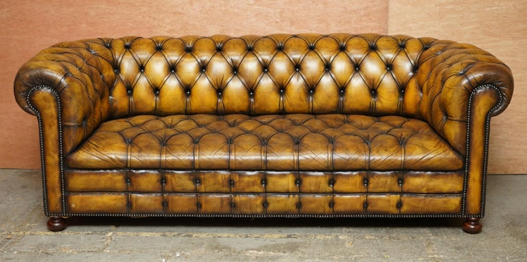 We are delighted to offer for sale this original Art Deco circa 1920's Whisky brown leather Chesterfield club sofa in restored condition with fully buttoned base   This is a very good find, you almost never come across early 20th century