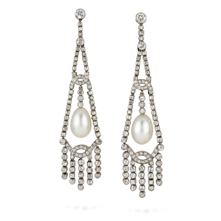 Women's or Men's An Important Pair Of Art Deco Pearl And Diamond Earrings For Sale
