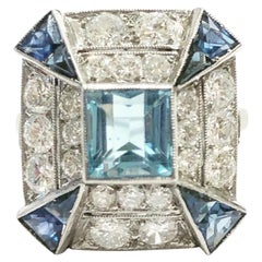 1920s Art Deco Platinum, Aquamarine, Diamonds and Sapphire Cocktail Ring