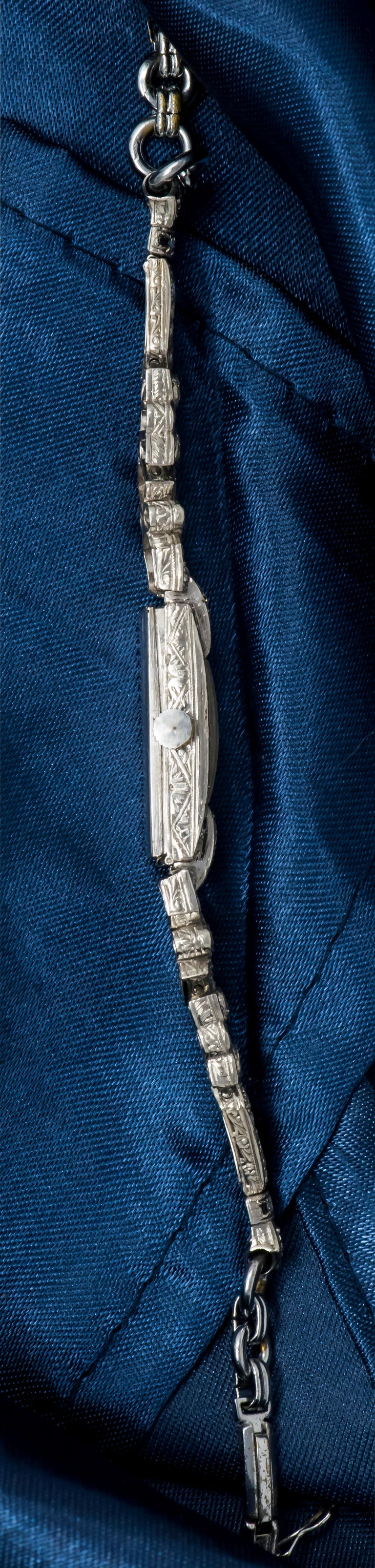 1920s Art Deco Platinum Egyptian Revival Diamond Set Bracelet Watch In Excellent Condition For Sale In New york, NY