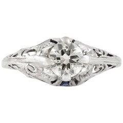 1920s Art Deco Platinum with 0.67 Carat Diamond and Sapphire Engagement Ring