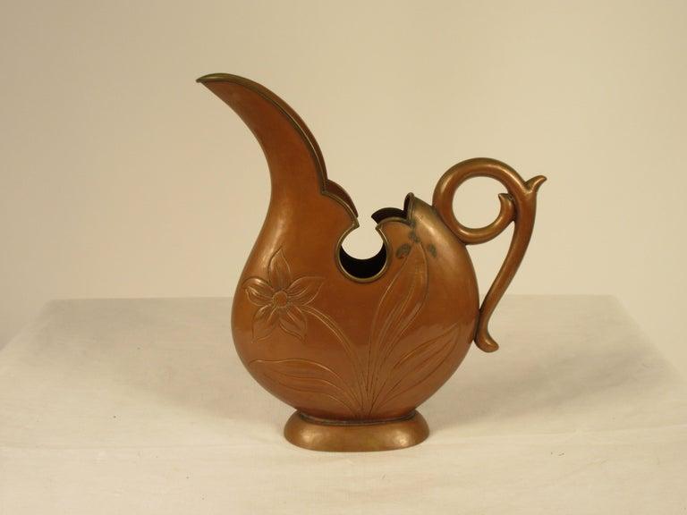 1920s Art Nouveau copper pitcher.